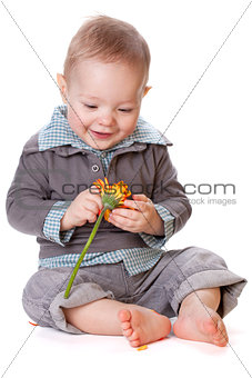 Smiling baby with flower
