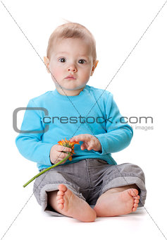 Small baby touching orange flower