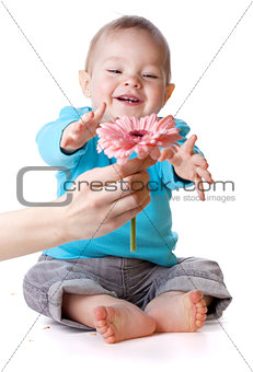 Smiling baby and flower