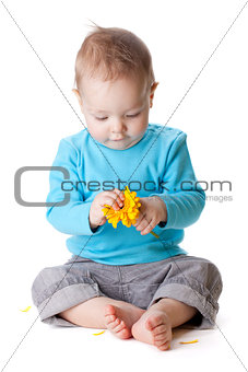 Small baby holding yellow flower