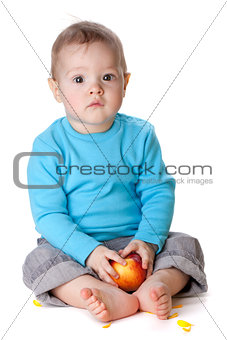 Small baby holding red apple
