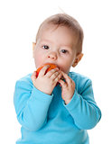 Small baby eating red apple