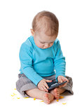 Small baby playing with calculator