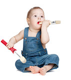 Small baby worker with paint brush and roller