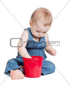 Small baby with toy bucket