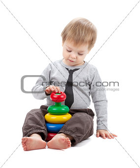 Small baby with a toy pyramid