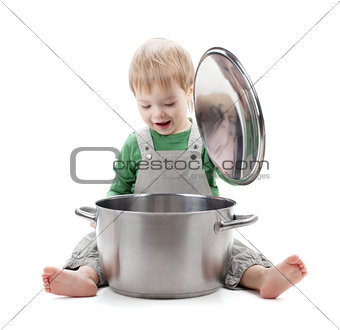 Baby looking inside saucepan
