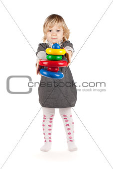Baby girl with a toy pyramid