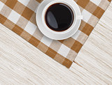 coffee cup top view on tablecloth over wooden table