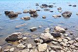 transparetnt water and big stones,