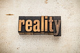 reality word in wood type
