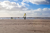 kitesurfer on sand beach at North sea