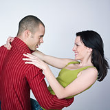 young  couple dancing hug smiling portrait