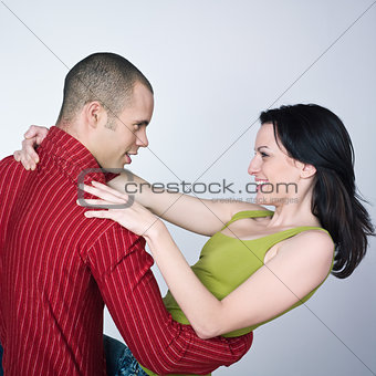 young  couple dancing hug smiling portrait