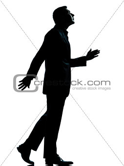 one business man walking looking up silhouette