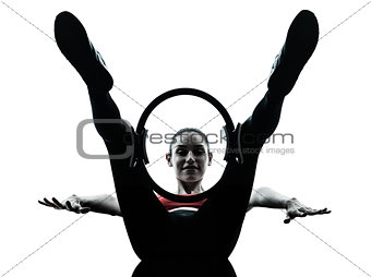 woman exercising pilates ring