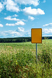 signpost in field with blue sky