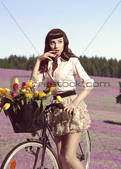 sensual girl posing near bicycle outdoor
