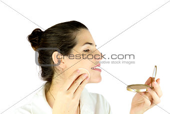Powdering her face