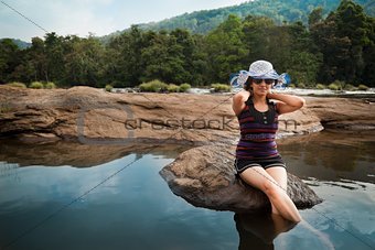 Woman relaxing in river