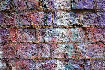 Old brick wall with graffiti