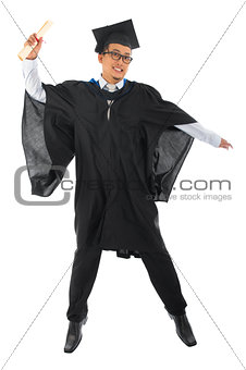 Asian male university student in graduation gown jumping