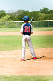 Teen baseball player at bat