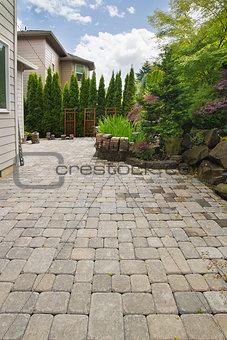 Backyard Brick Paver Patio with Pond