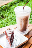 Refreshing break with cold coffee and chocolate cake