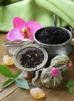 assortment of tea - black leaf, green, exotic and tea strainers