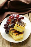 cream biscuits with berries and chocolate