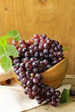 organic ripe black grapes on a wooden table