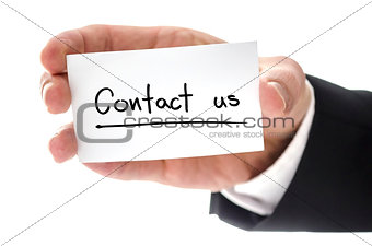 Business man holding business card with Contact us written on it