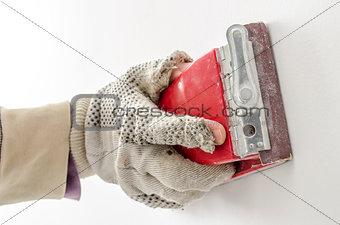 Polishing a wall closeup