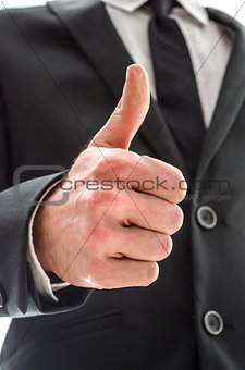 Business man showing a thumbs up sign