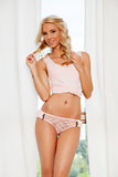 beautiful blonde in pink lingerie