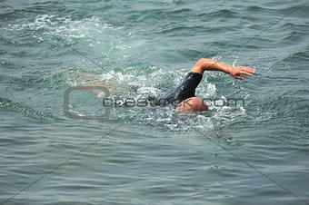 man floating in the sea
