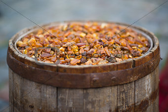 old barrel filled with amber
