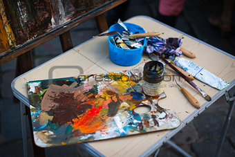 palette with paintbrush and palette-knife