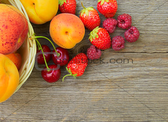 Ripe Sweet Berries and Fruits on the Wooden Table