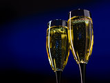 Two Glasses of Champagne on Dark Blue Background