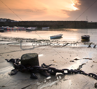 Fishing boats in harbor at sunrise long exposure landscape