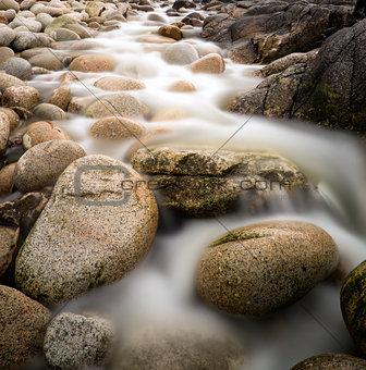 Beach landscape ancient rocks Porth Nanven Cornwall England