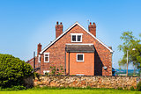 Typical English house on blue sky