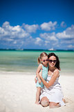 Mother and her little daughter at tropical beach
