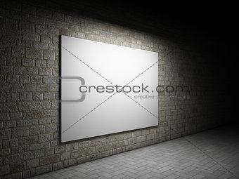 Blank billboard on a brick wall at night