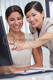 Asian Chinese & Hispanic Businesswomen Using Office Computer