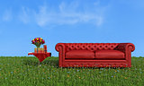 Red leather luxury sofa on grass