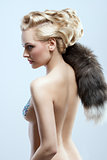 girl with fur accessory and creative hair-style