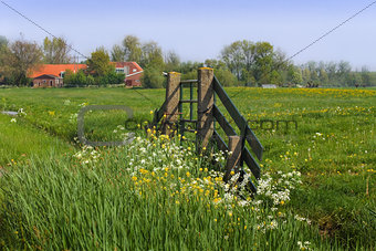 Gate and farm in Dutch country landcape